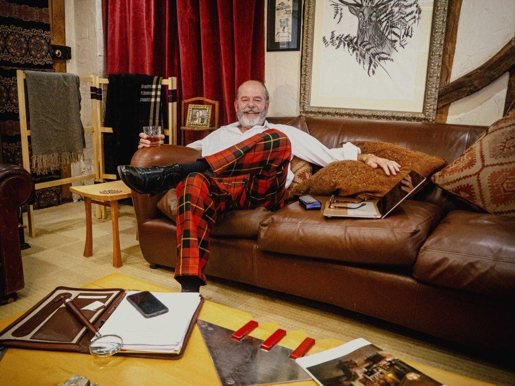 Mark Lewis on sofa
